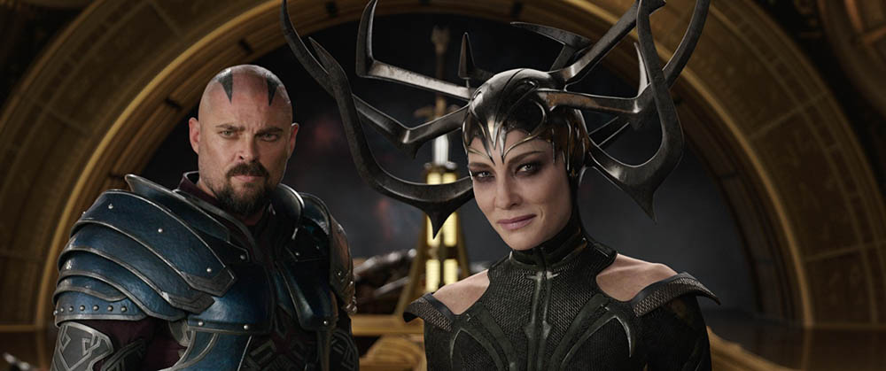 Skurge (Karl Urban) and Hela (Cate Blanchett)