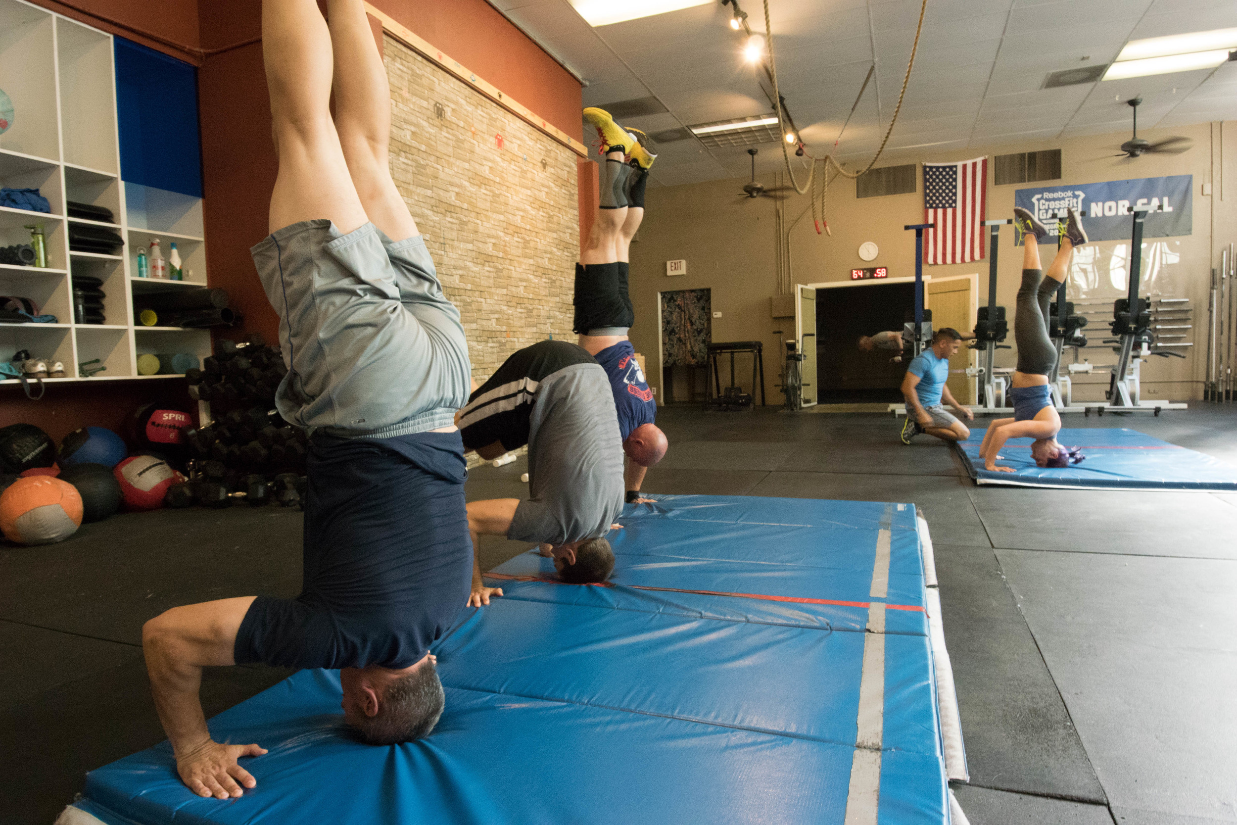 The 4:30 class shown working on pike to headstand to handstand!
