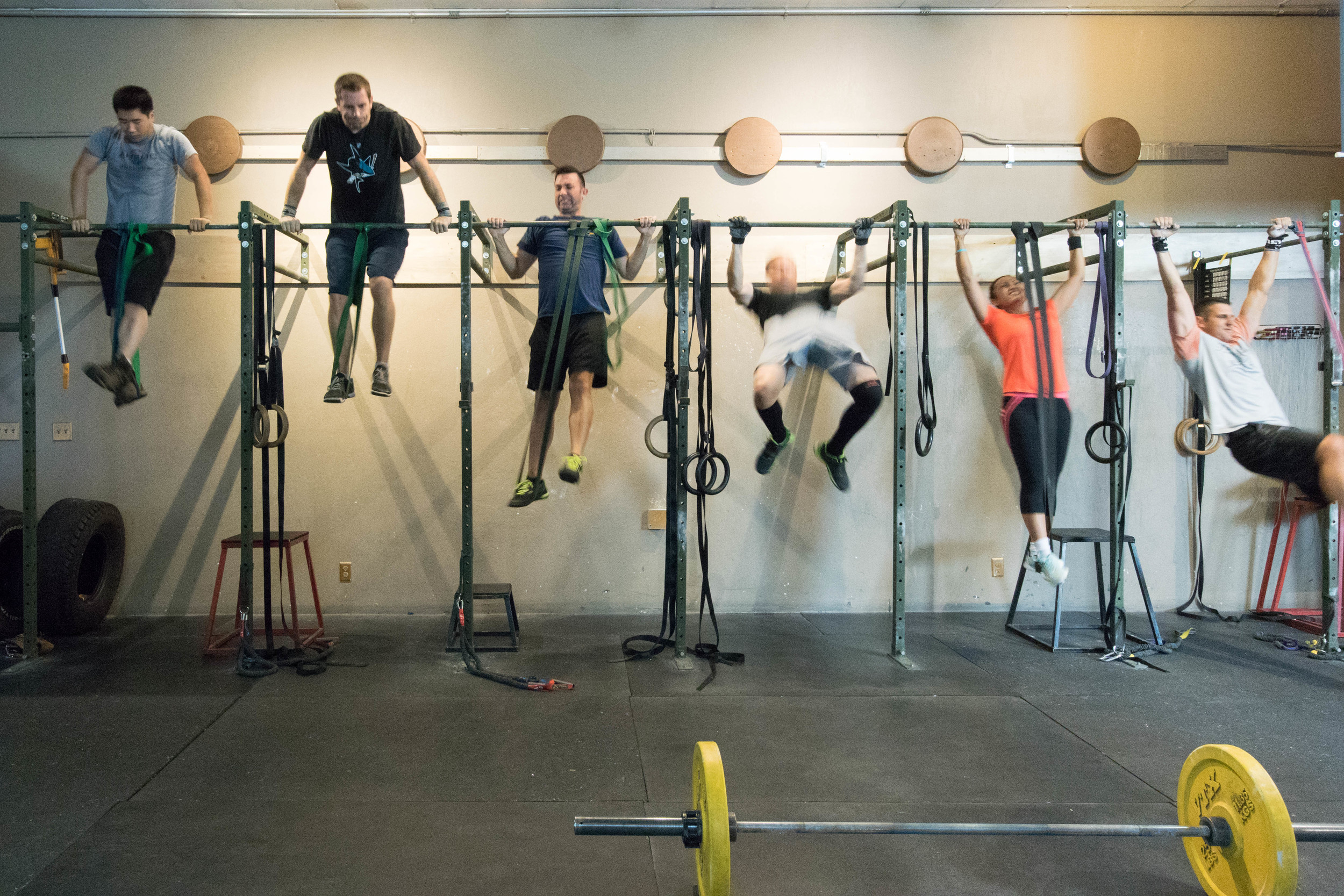 Andrew, Erik, Kalem, Tedd, Lilly and TJ work on the bar muscle up skill!