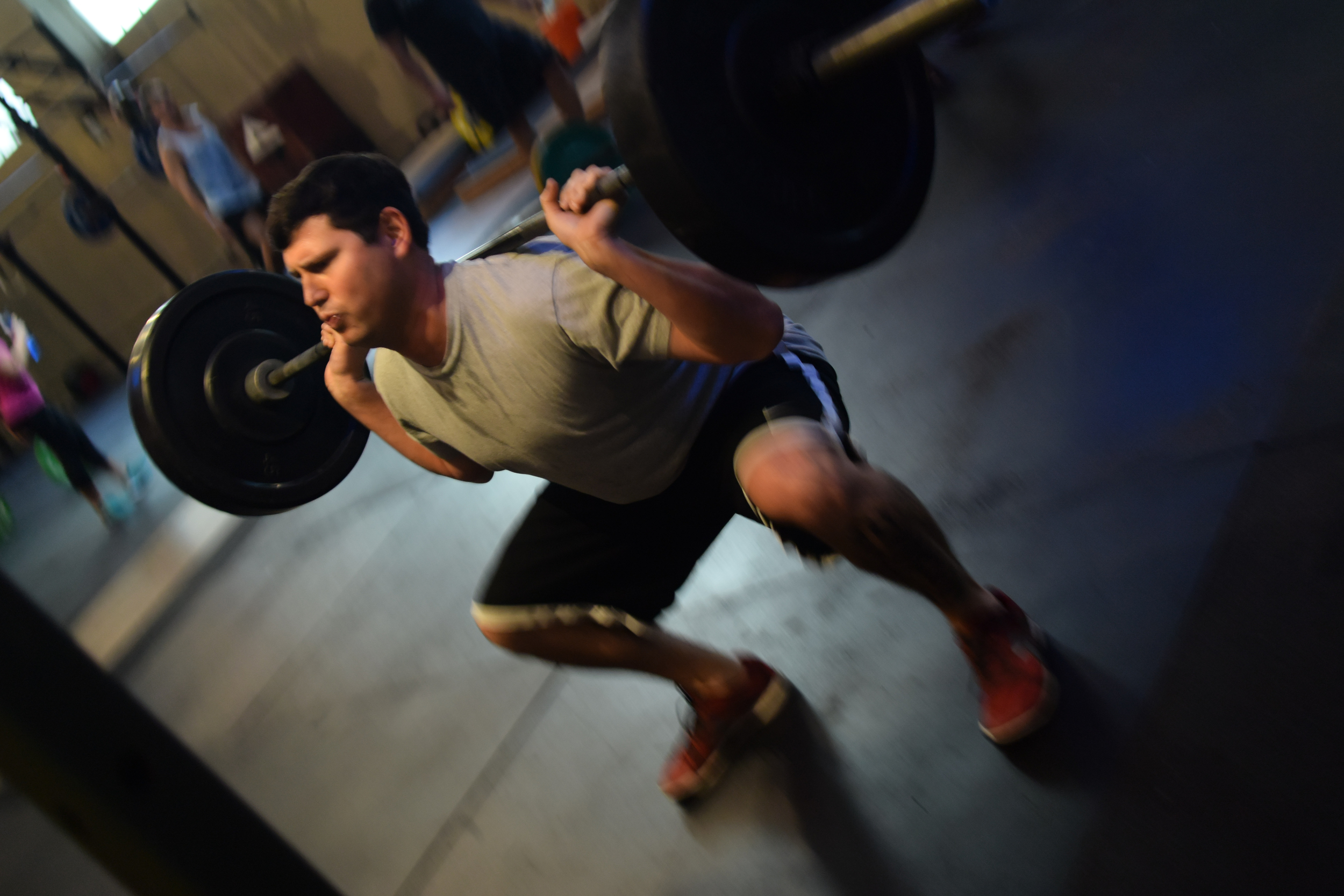 By activating his hips, Shane is able to keep his torso upright while dropping deep into full squat depth.