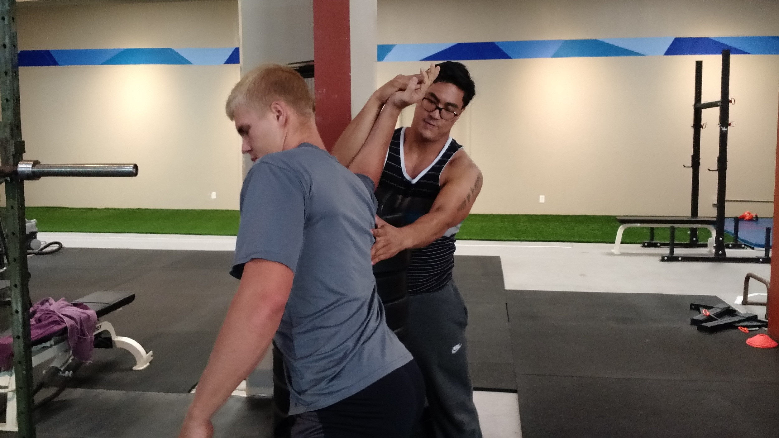 During Sunday's RESTORE! class, coach Raymond works on CJs shoulder mobility especially helping his cleans and front rack positioning.