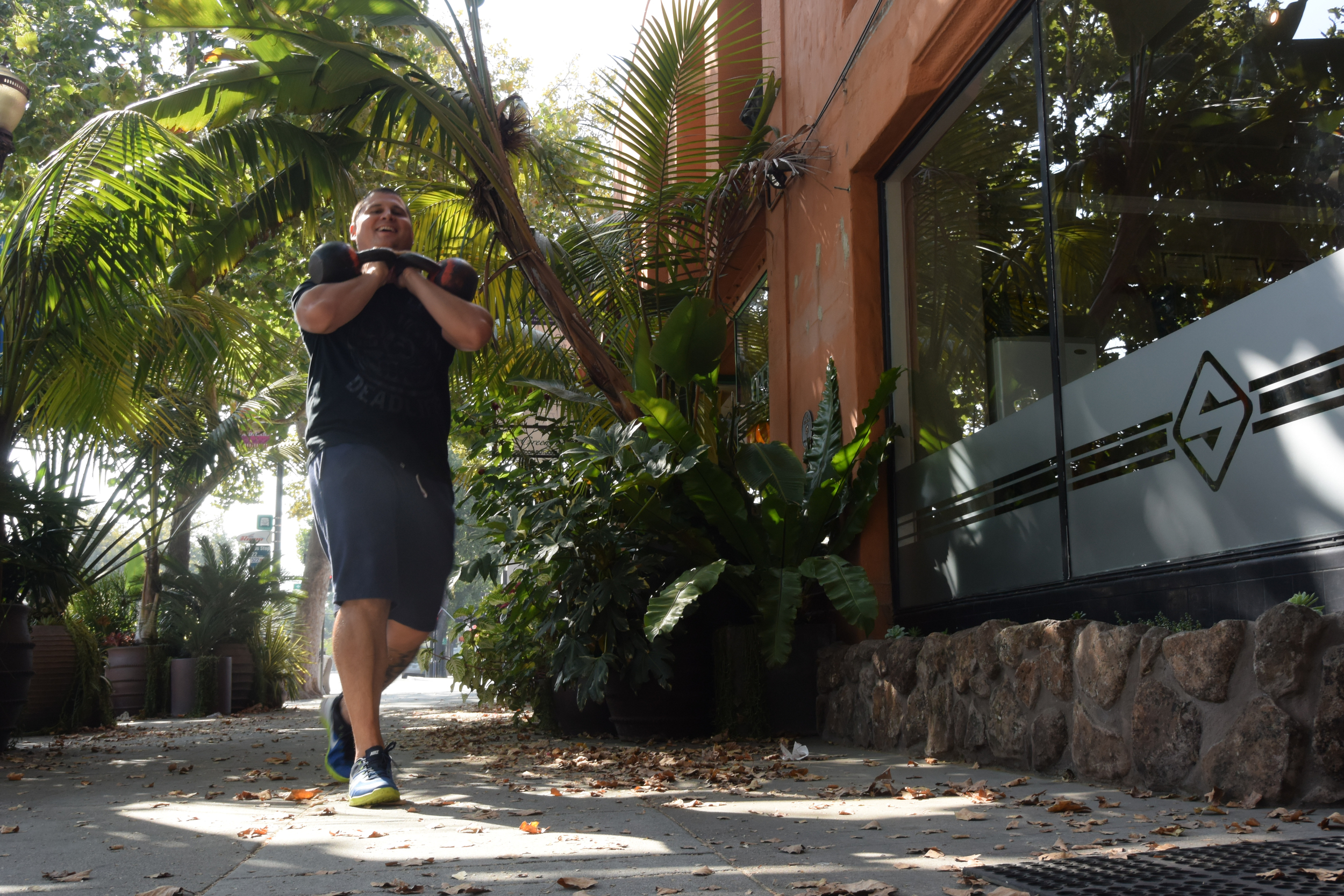 Shane likes long walks in the park- with kettlebells in the rack position.
