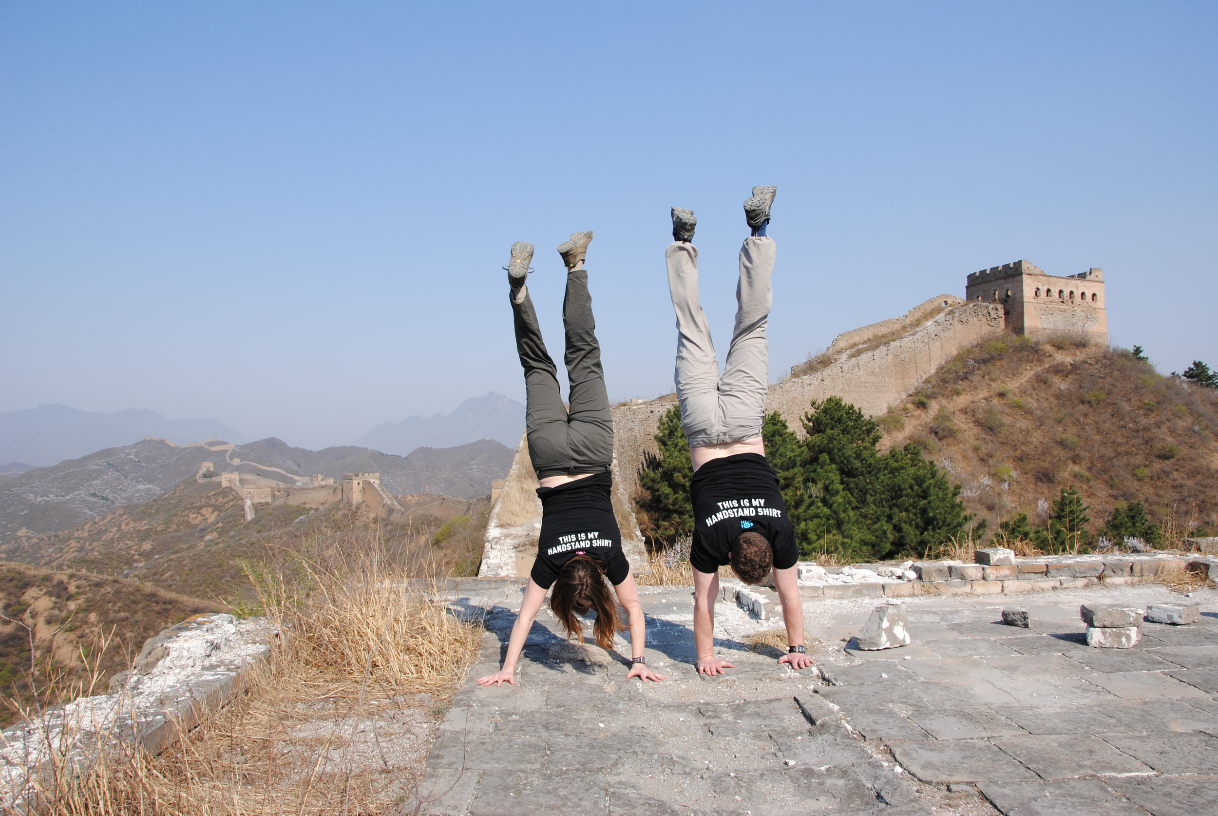 Robin M And Tyler F showing off in front of the great wall of china!!
