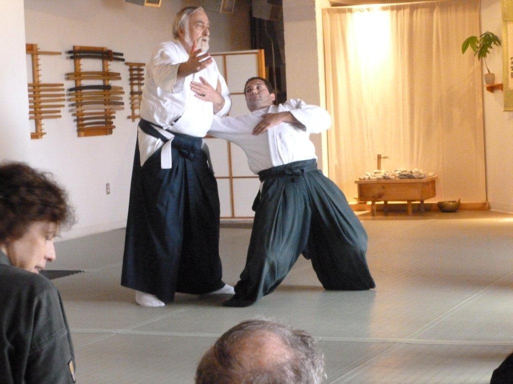 Sensei von Krenner demonstrates a variant of kote muwashi on Ken Jeremiah. Sensei Don Culp is in the foreground.