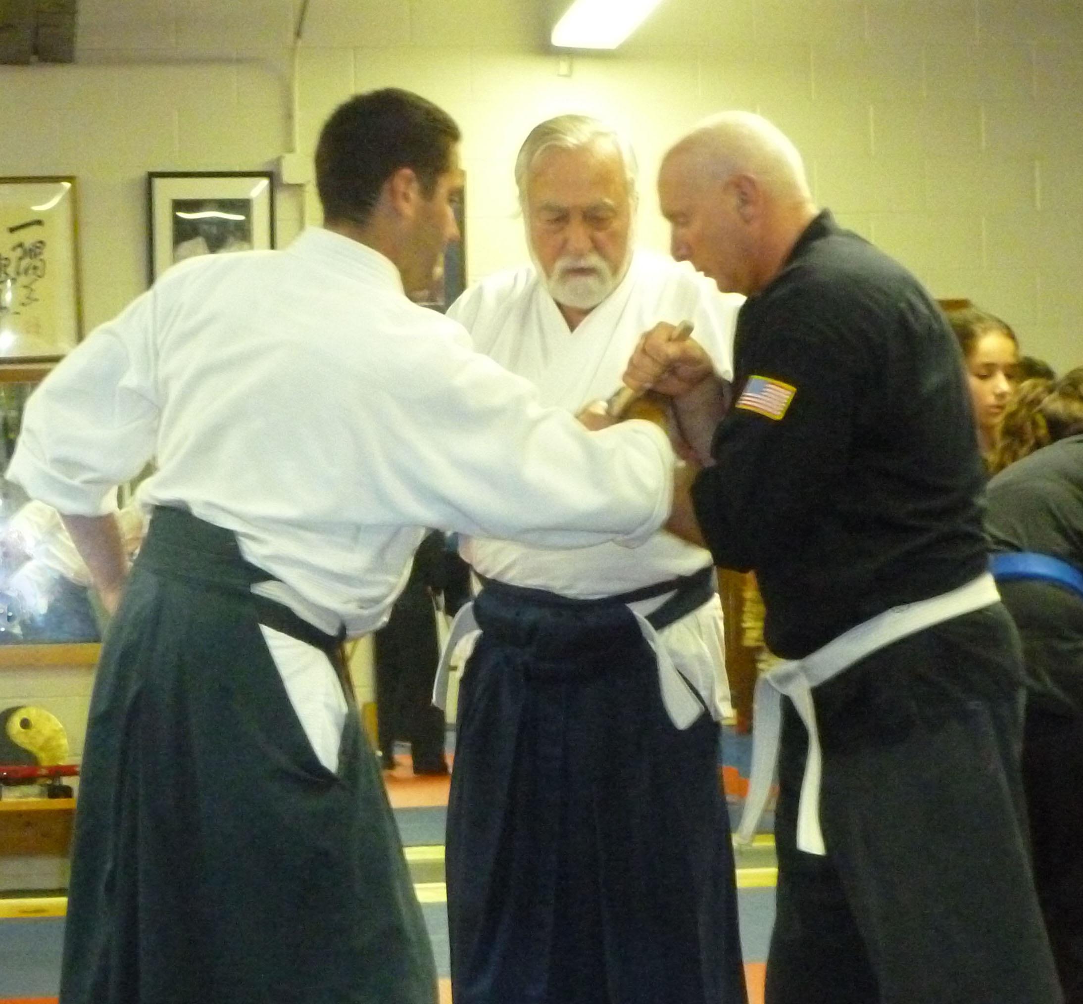 Demonstrating tessen compressions with Ken Jeremiah, at Don Culp's Karate Studio, RI.