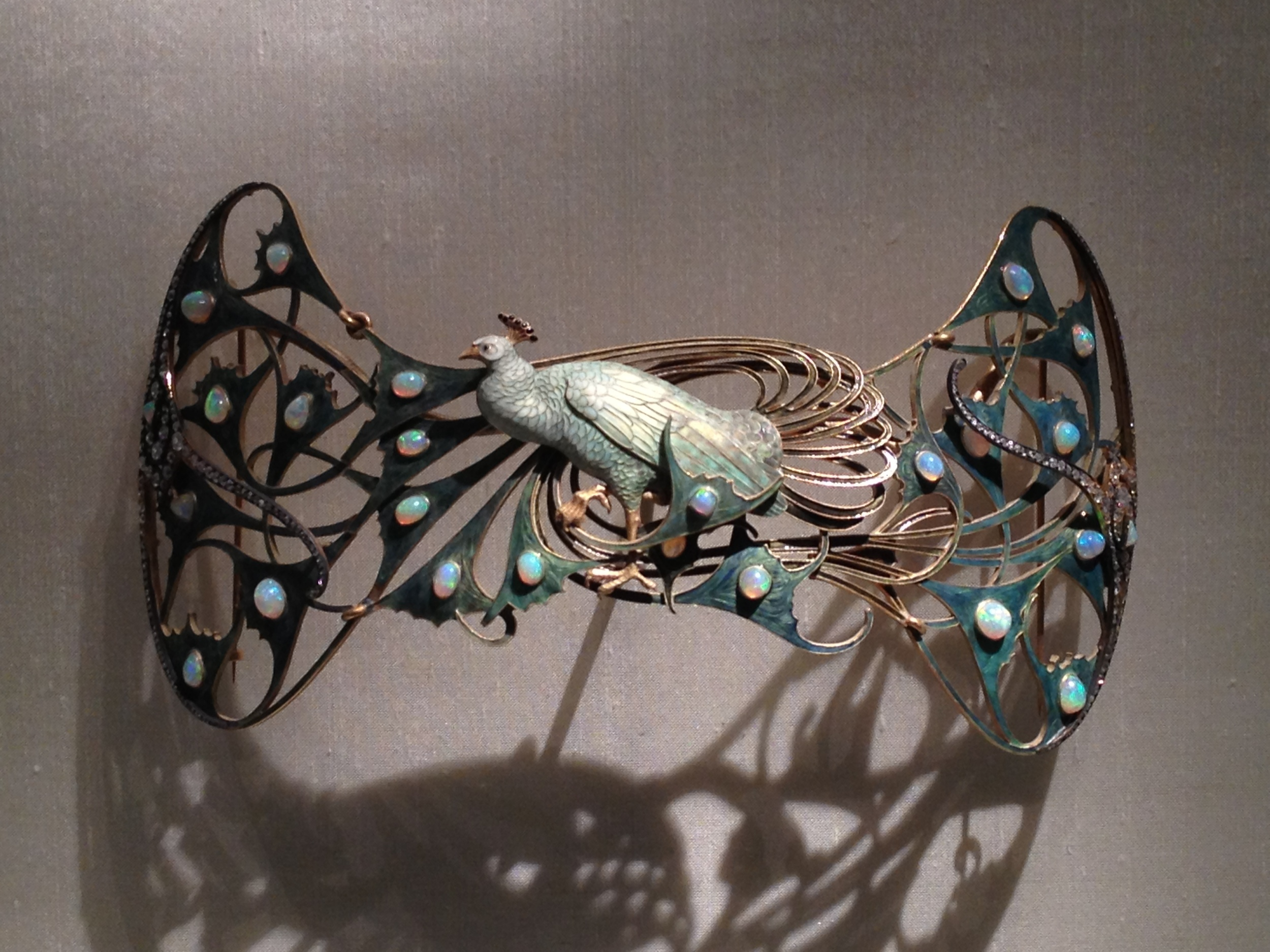 "Rene Lalique ""Peacock Corsage Ornament"" c. 1898-1900 Gold, enamel, opals and diamonds"