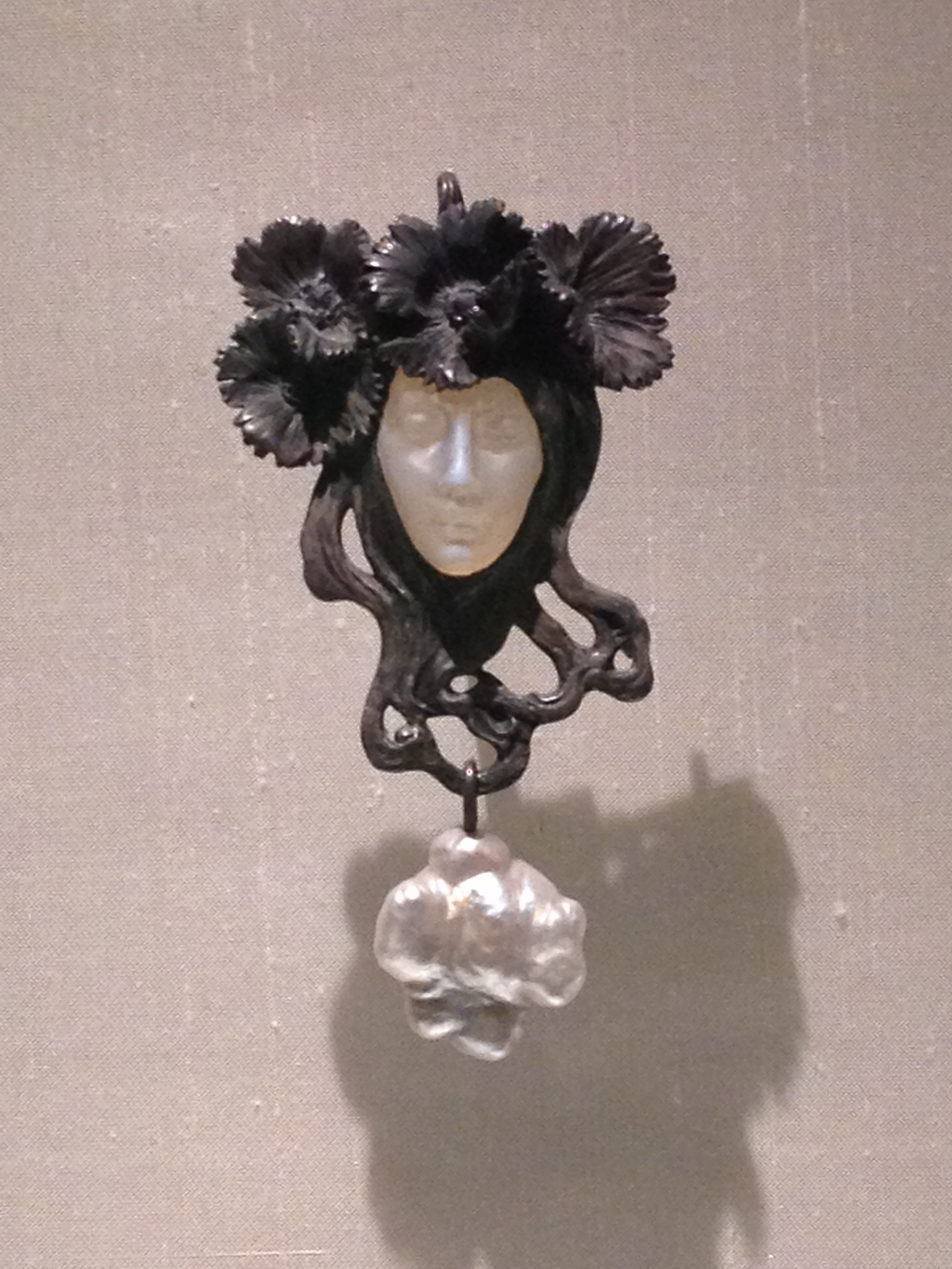 "Rene Lalique ""Female Face"" pendant c 1898-1900 Silver, enamel, glass and baroque pearl"