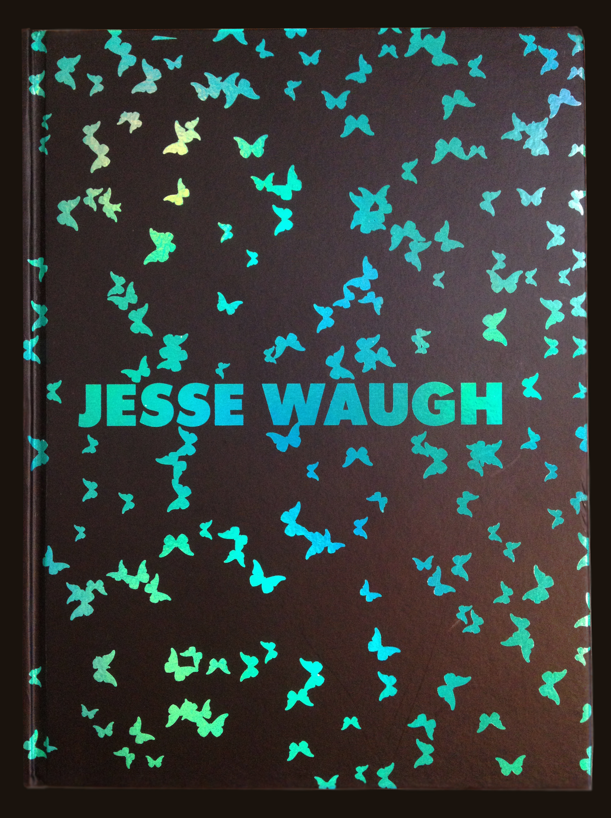 Blue iridescent foil-stamped cover of the limited edition print copy of Jesse's artist monograph  JESSE WAUGH: Portrait of an Artist and His Strivings for Pulchrism