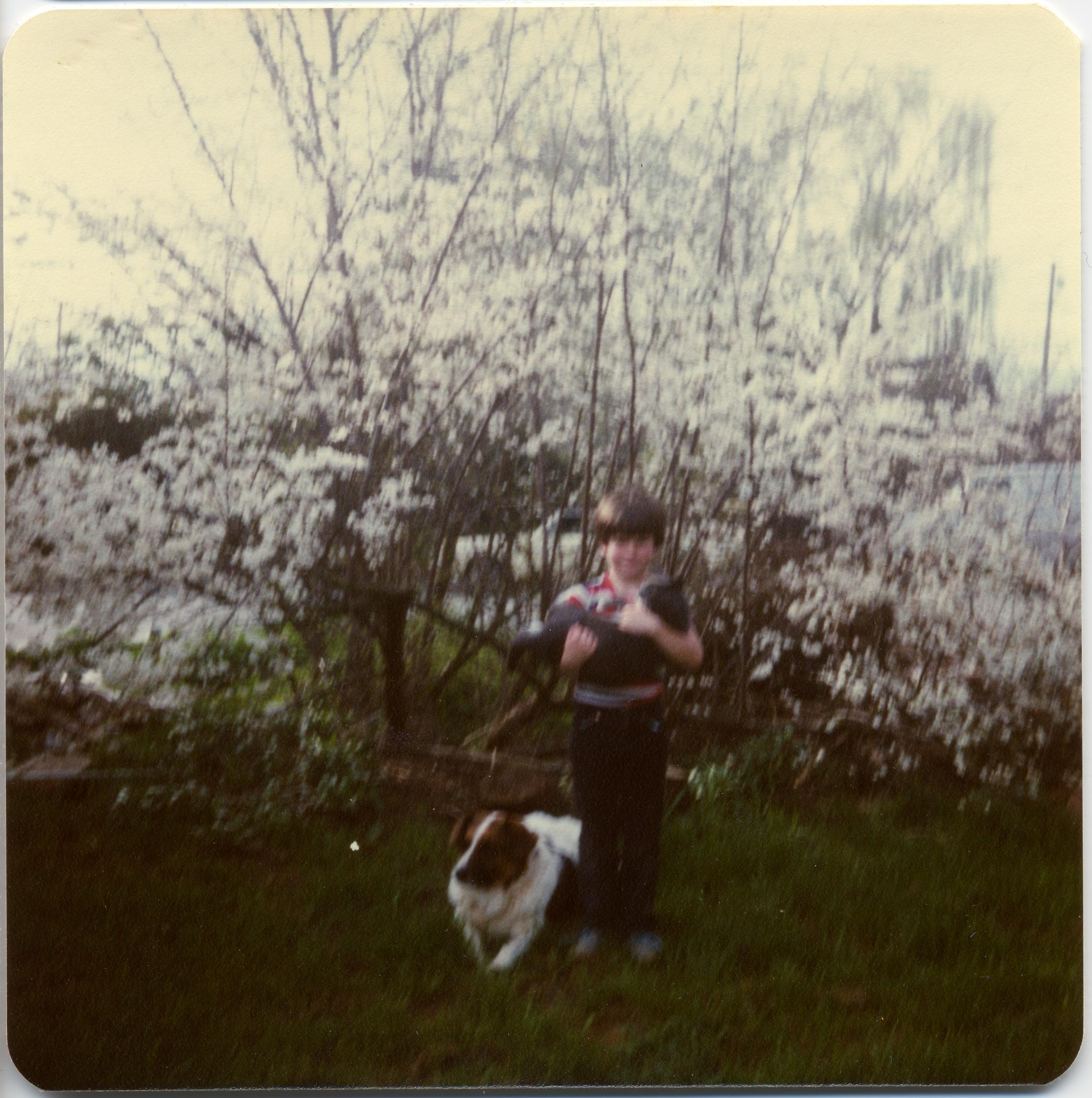 1982 HOLDING GUY W JOHN.jpg