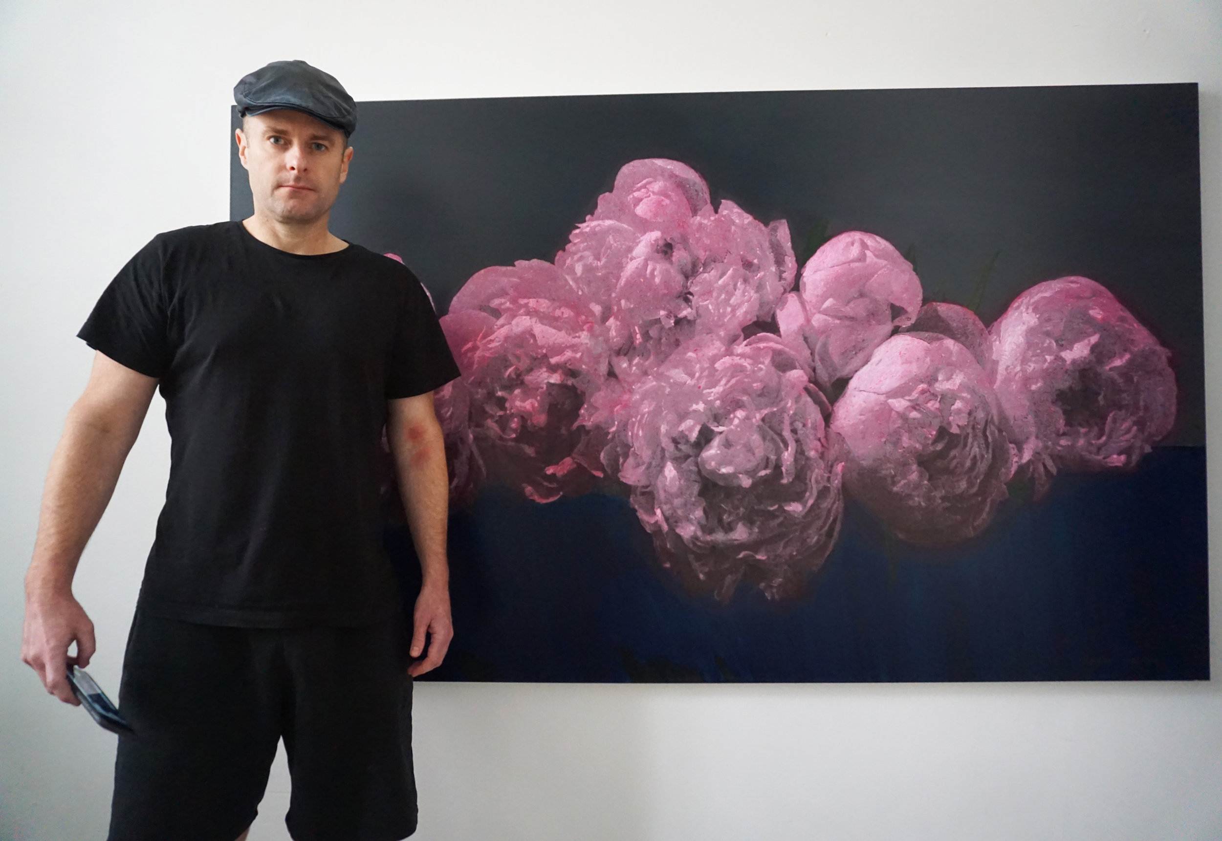 JESSE WAUGH  with his painting   Peonies Faith
