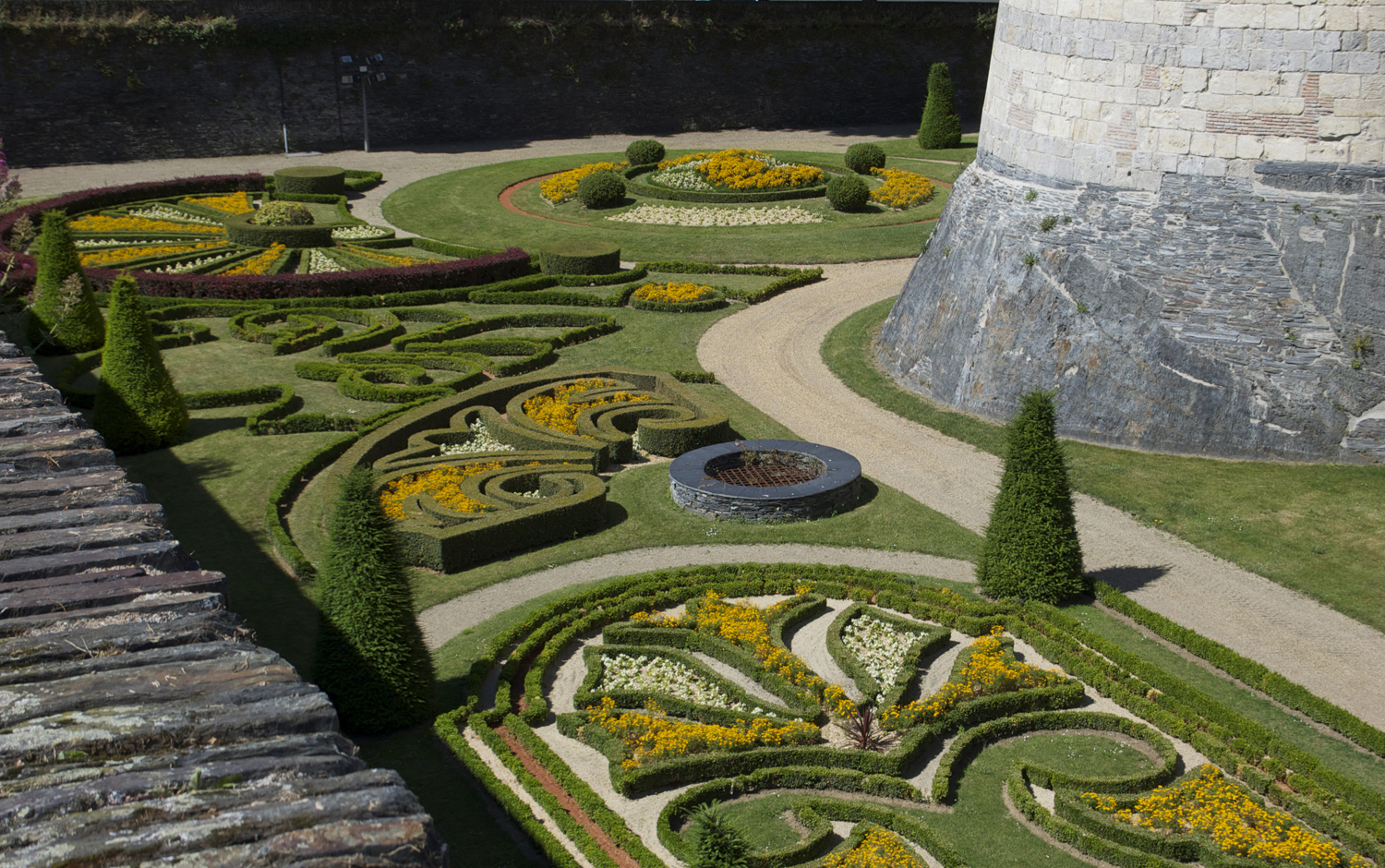 Formal gardens in the moat