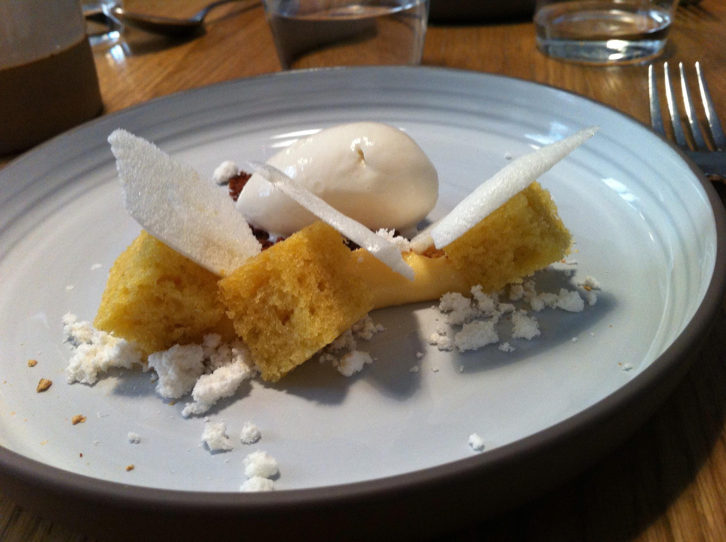 Lemon cake, cream and sorbet with meringue