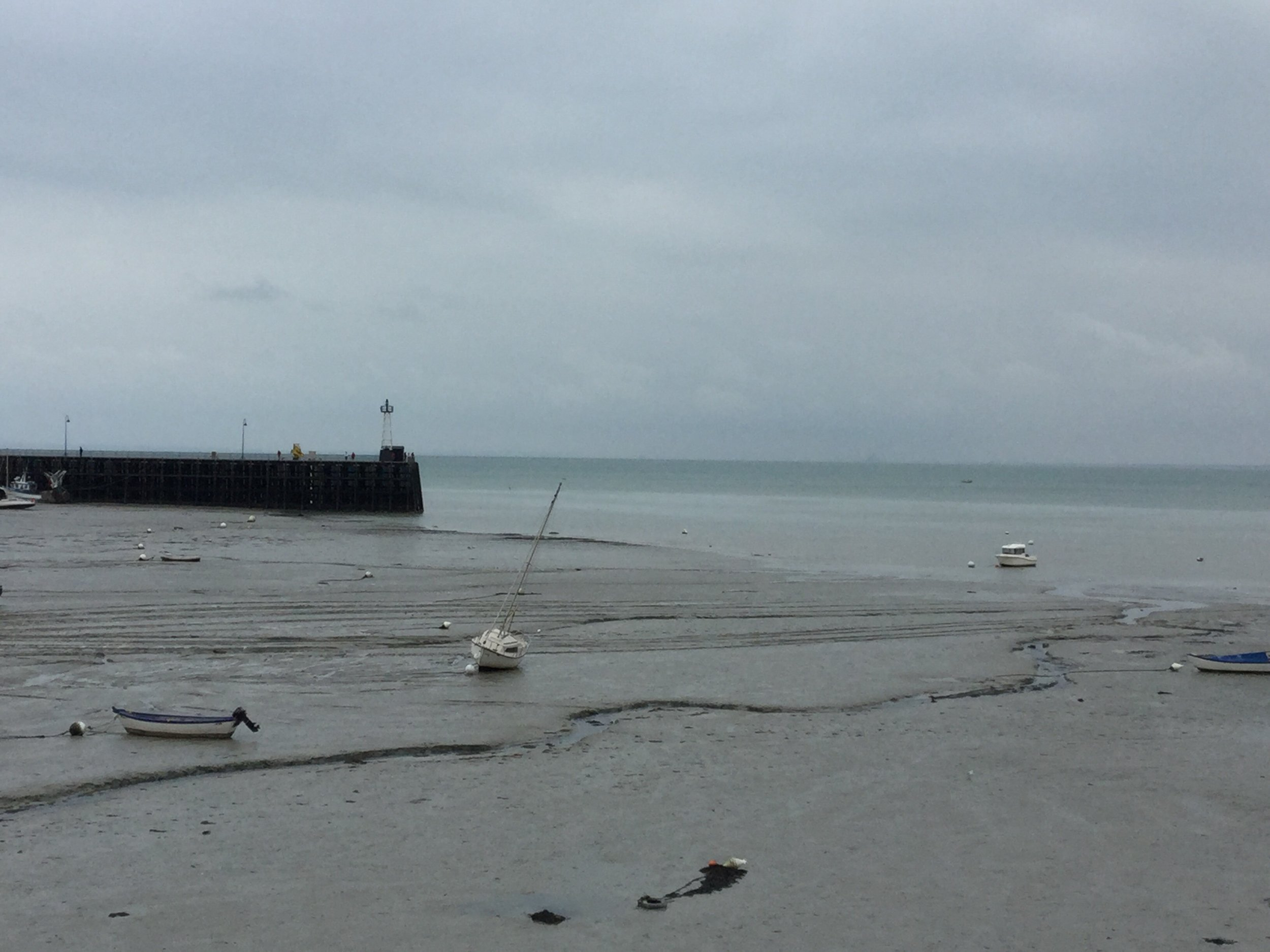 Mont St Michel is barely visible on the horizon.