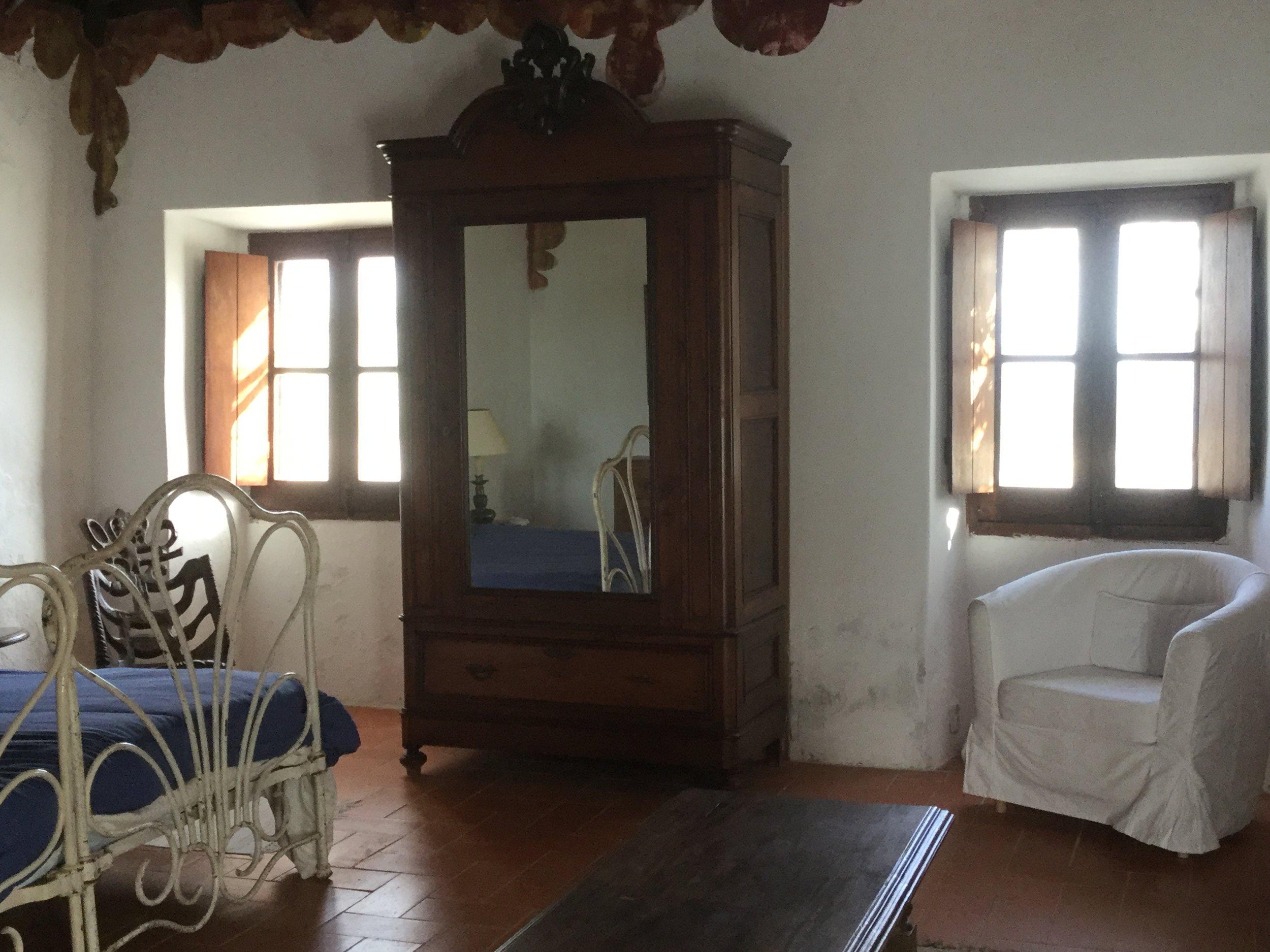 The master bedroom with door to the terrace