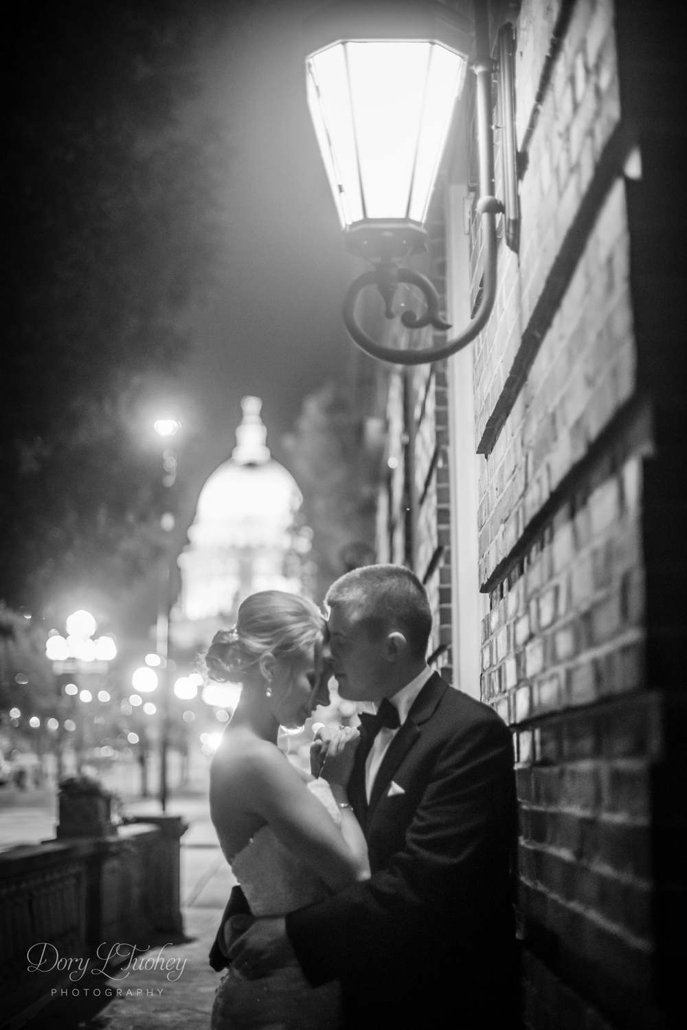 Ahhh!!! Love this night shot! Everything about it - the capitol building in the back, the brick wall, the lantern above... LOVE.