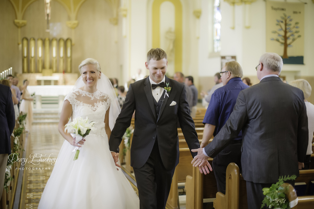 Always a favorite shot as the newly wed couple exits the church!
