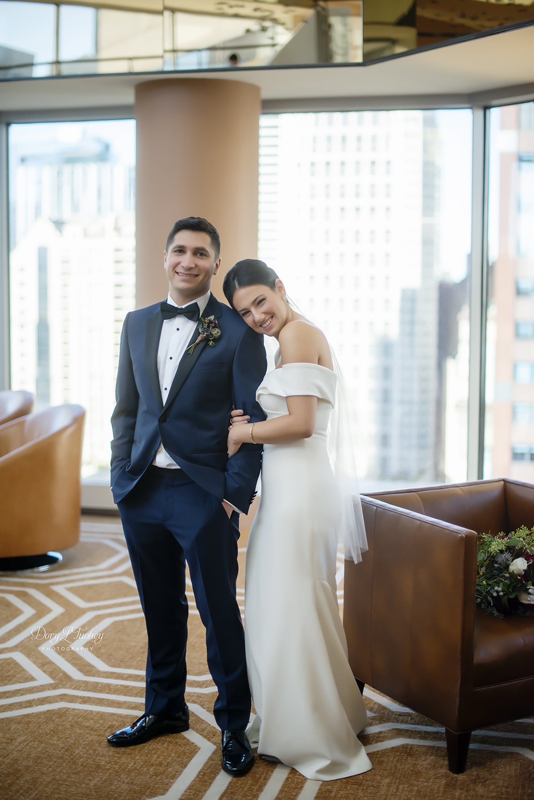 Conrad_hotel_chicago_bride_wuite_wedding_BHLDN_orange_sofa_gorgeous_natural_light_dory_tuohey_photographer_Navy_pier_elite_yacht_groom_01.jpg