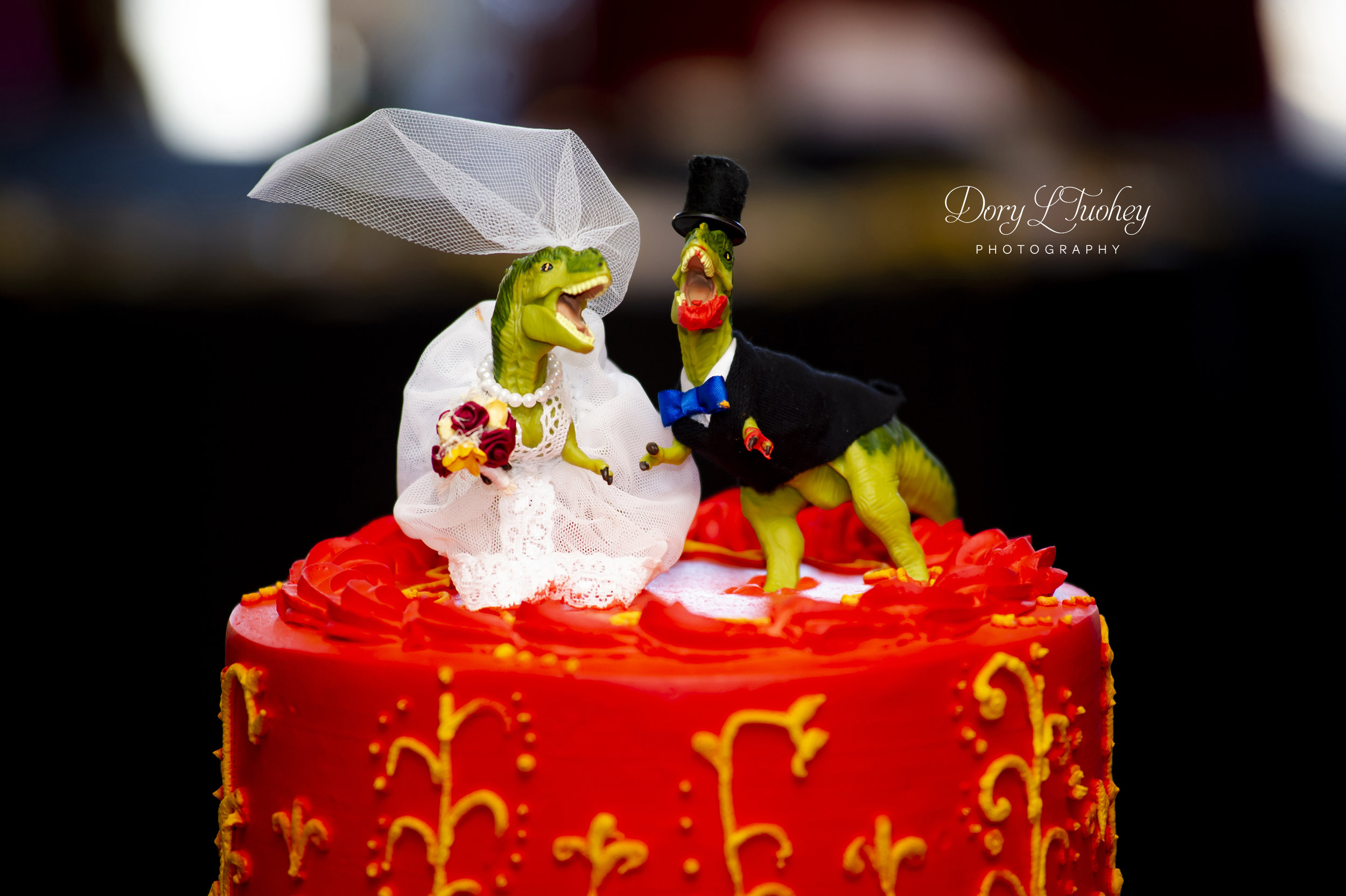 Check out this cake topper! Caught red handed! Apparently the groom couldn't wait to dig in!