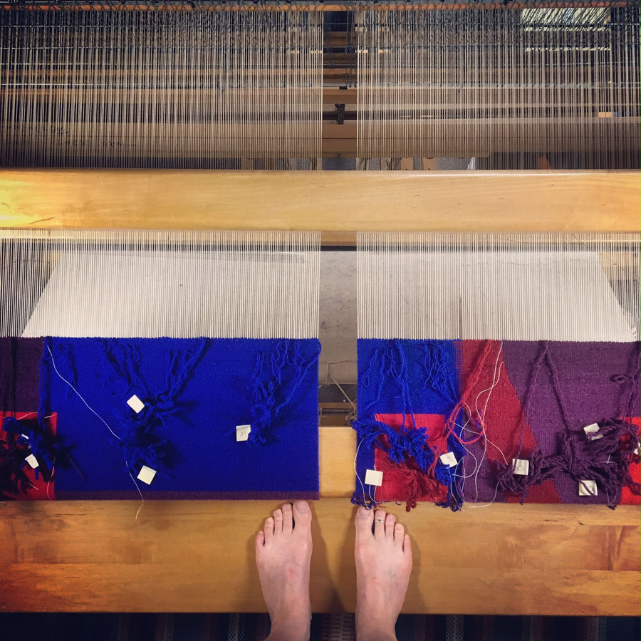 I weave on a countermarche loom. In this photo I'm standing on the loom bench with the camera up near the ceiling shooting straight down. The wooden bar in the middle of the photo is the top of the hanging beater. I also weave from the back, so what you see is the back side of the tapestry.#harrisvillerugloom