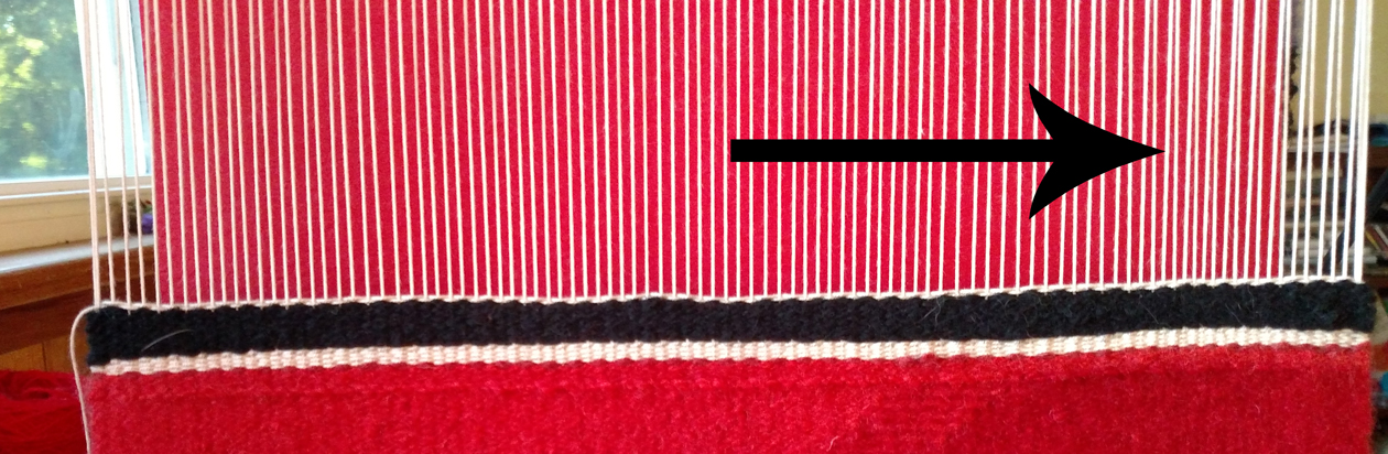 This example is subtle, but can you see how the warps near the arrow are closer together than the rest of the weaving?