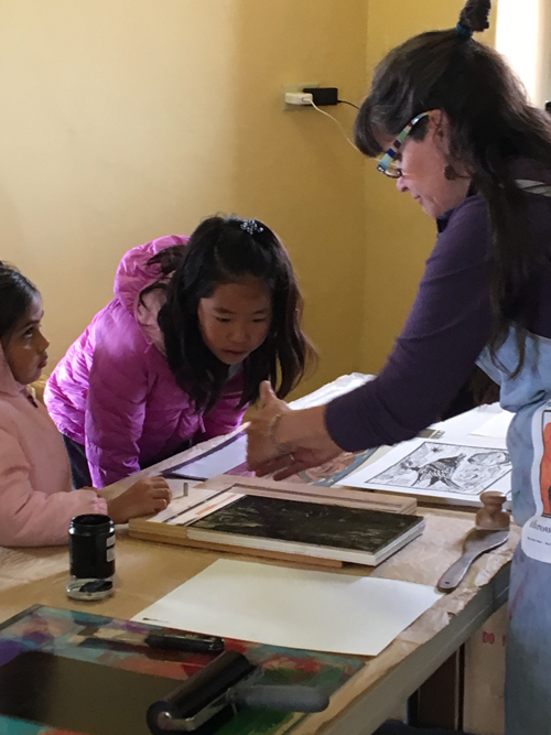 Amanda Palmer, artist-in-residence, teaching the kids http://www.followyourblissnotecards.com/