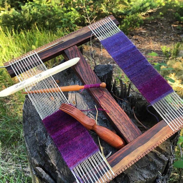 Weaving on a Hokett loom in the woods