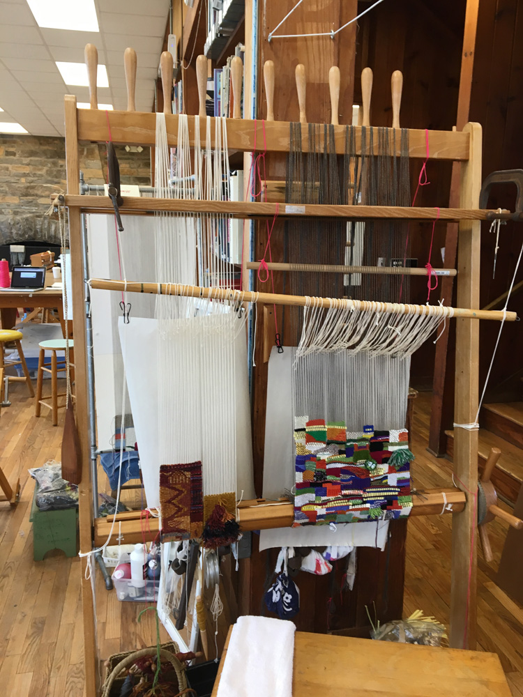 Warp-weighted loom with tapestry diary on the right.