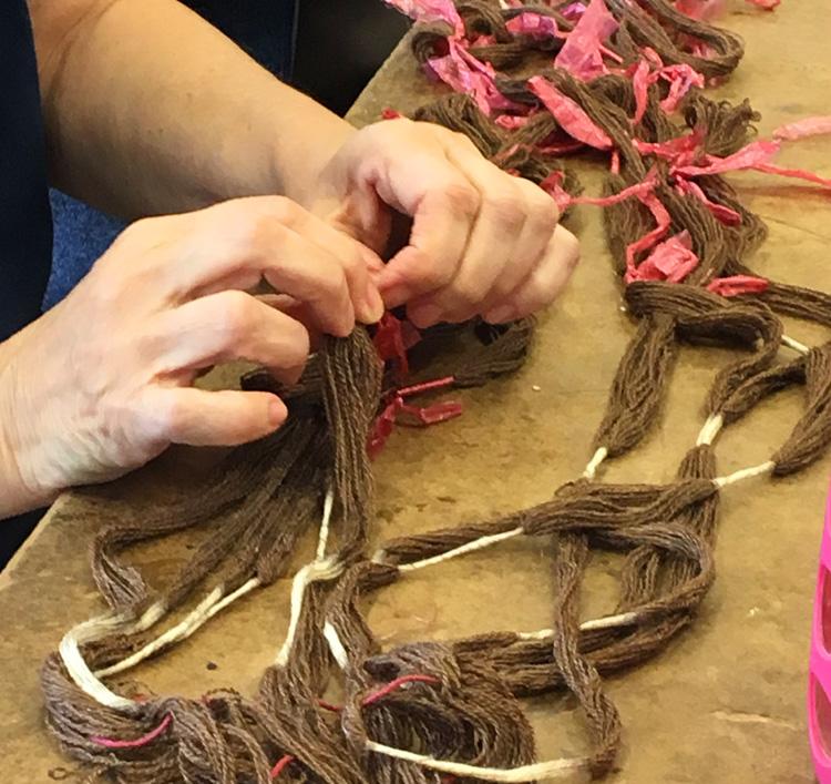 Dorina untying her ikat warp after dyeing it in black walnut. I believe it was also destined for the indigo pot.