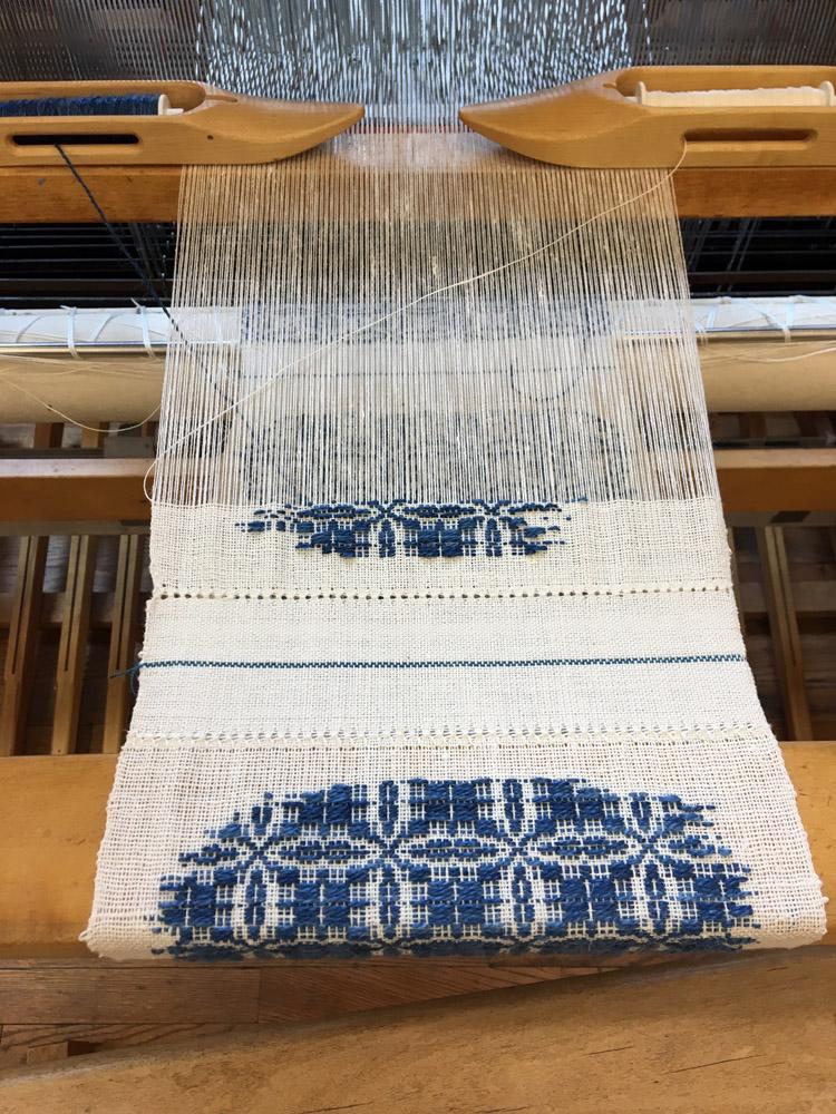 Nancy Nordquist, overshot work on a Macomber loom