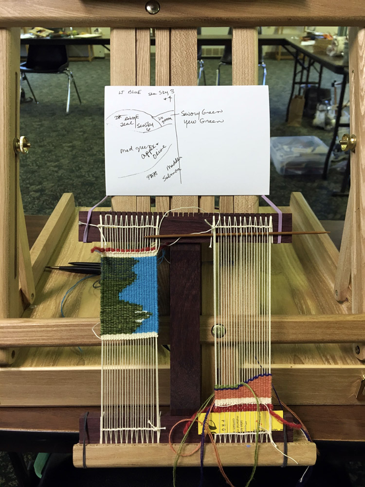 Kathy was using an artist's box easel to hold her Hokett loom. It worked very well! Her tiny mountain scenes were enchanting.