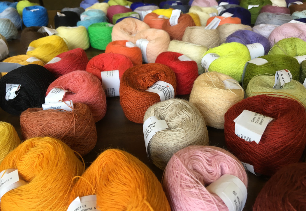 Yarn by Weaver's Bazaar. Yes, they are in the UK but shipping of their yarn to the USA is remarkably inexpensive considering the ocean in between. This yarn is wonderful for this kind of weaving on little looms.