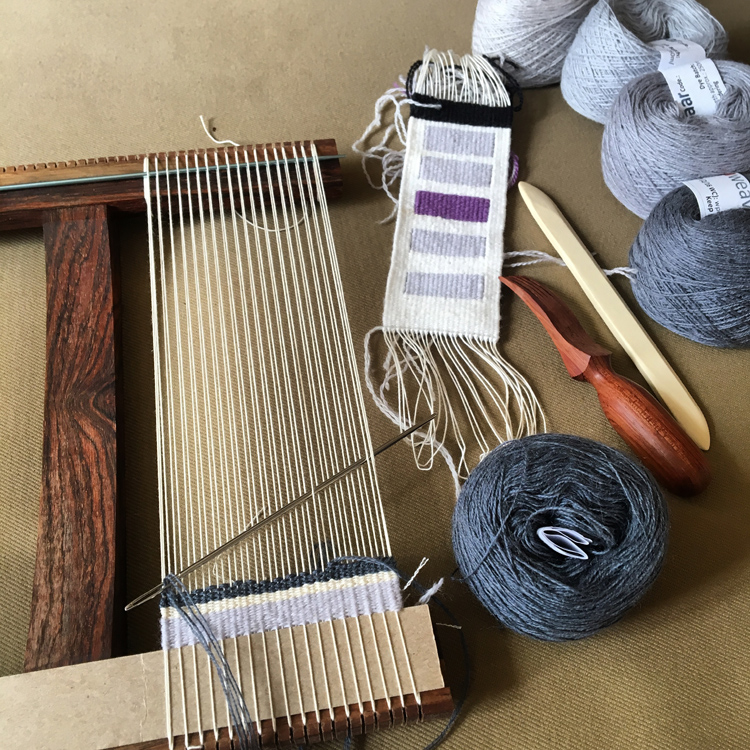 This is a Hokett loom, intermediate size (about 9 x 10 inches). There are many other kinds of simple looms out there. Tools pictured are long yarn needle, tiny beater, and a shed stick (the white thing to the right).
