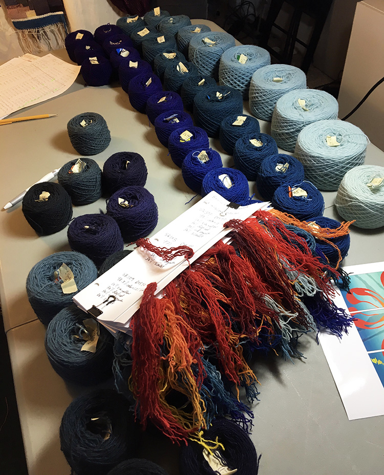 Yarn sample cards, tagged balls, and potential colors. Rebecca Mezoff, tapestry