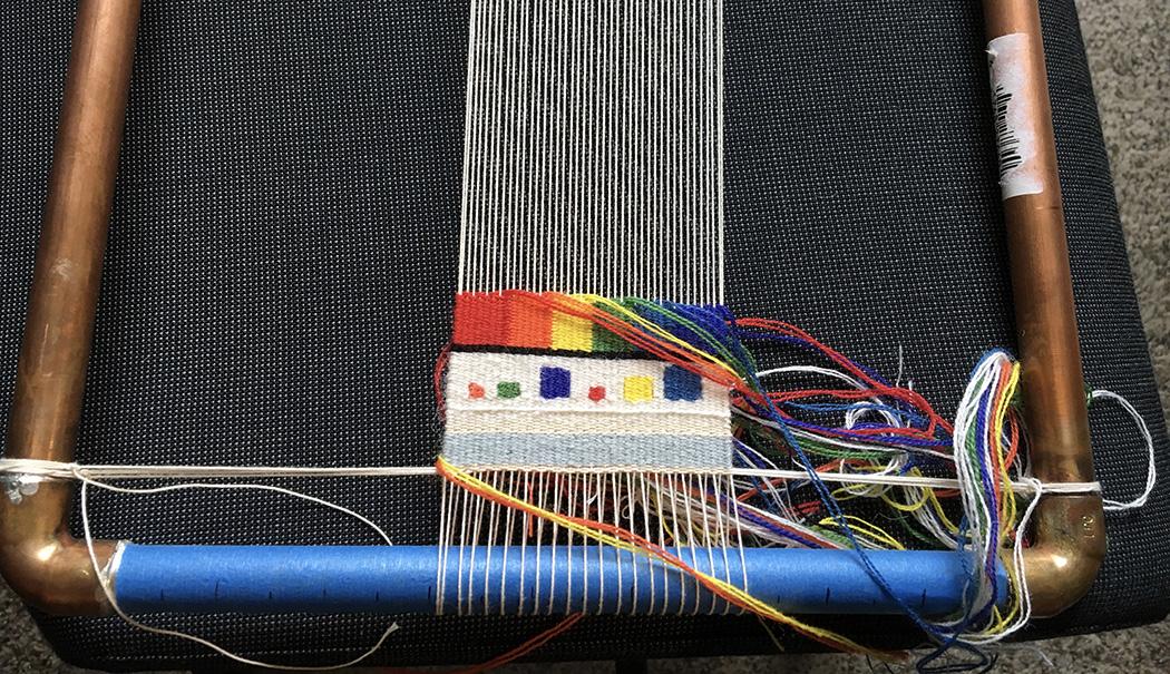 14 epi sett on a pipe loom. Weft yarn is Weaver's Bazaar 18/2.