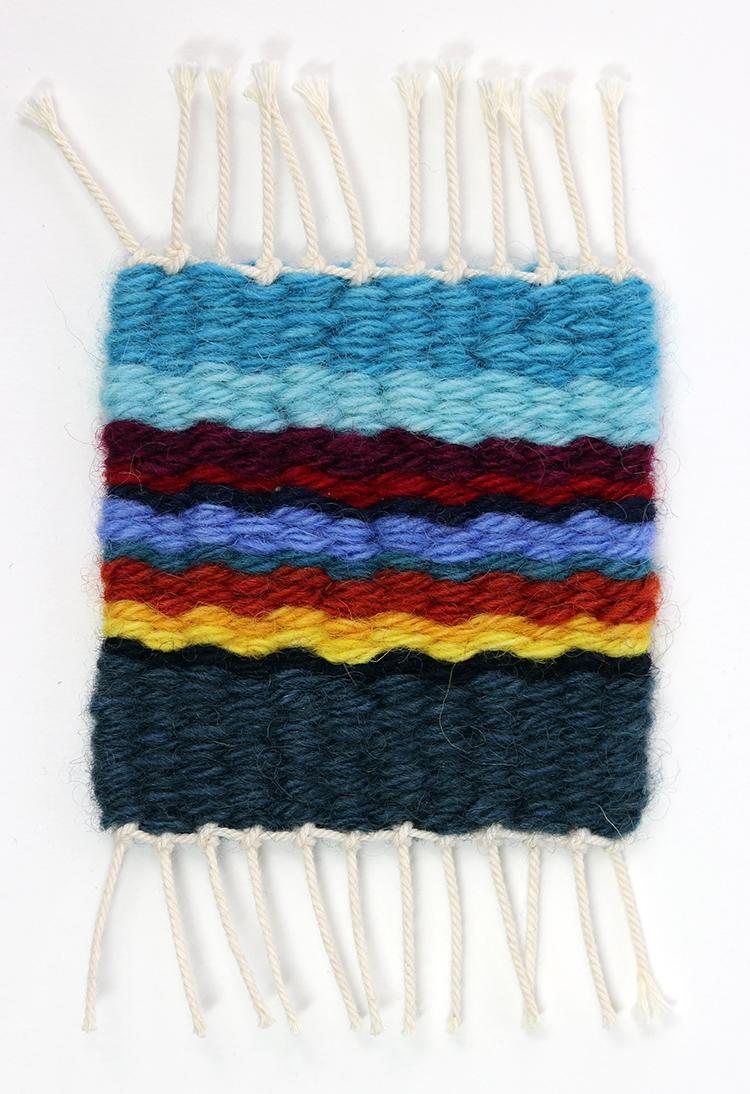 Tapestry sett example, 4 epi on 12/15 cotton seine twine warp with 6 strands of Harrisville Designs Koehler singles.