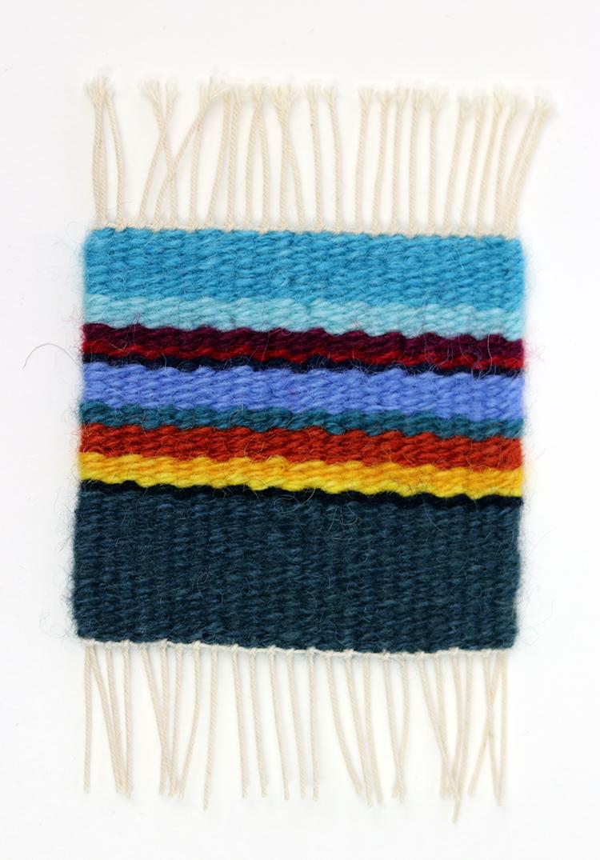Tapestry sett example, 8 epi on 12/6 cotton seine twine warp with 3 strands of Harrisville Designs Koehler singles.