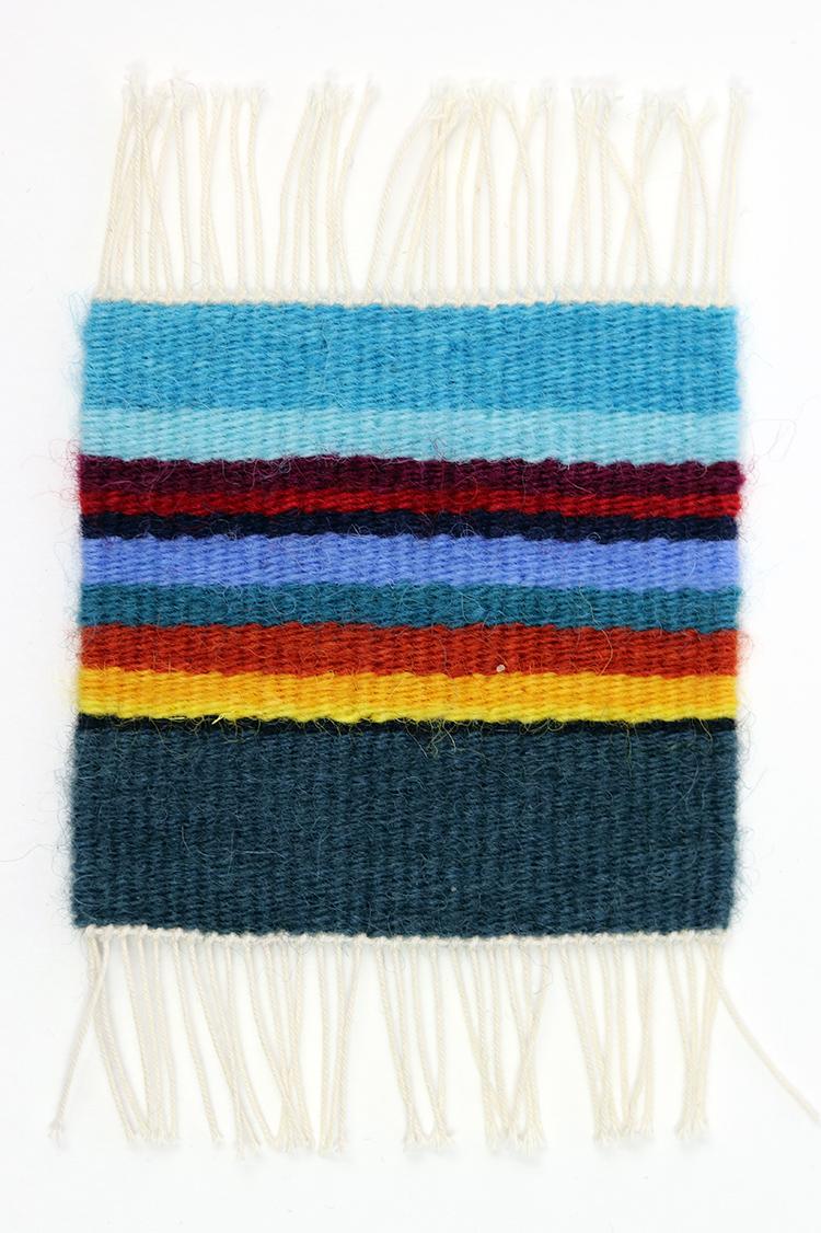 Tapestry sett example, 12 epi on 20/6 cotton seine twine warp with 1 strand of Harrisville Designs Koehler singles.