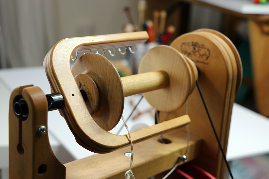 Schacht Ladybug spinning wheel with bobbin in the flyer