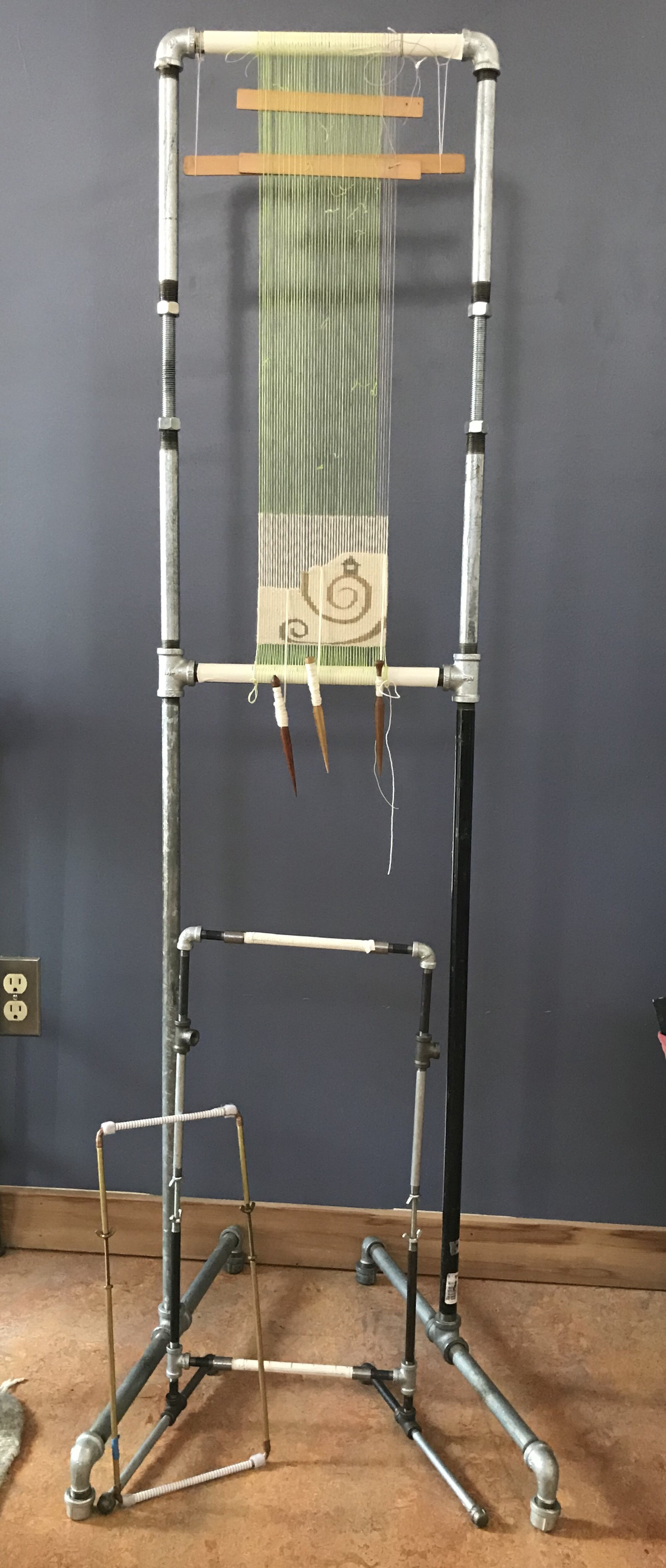 Four selvedge piece on a pipe loom