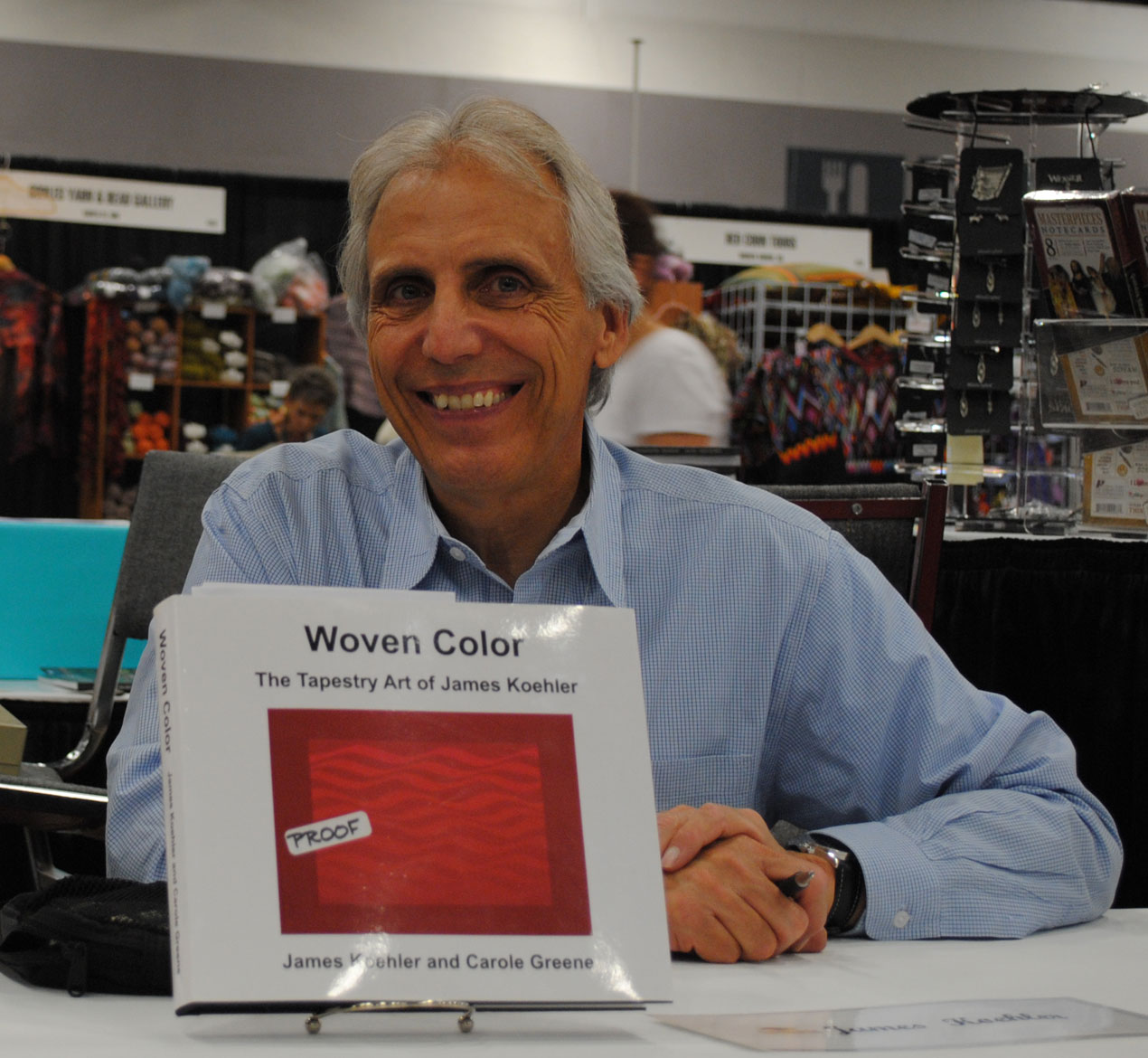 James Koehler with his book shortly after it came out at a Convergence 2010 book signing.