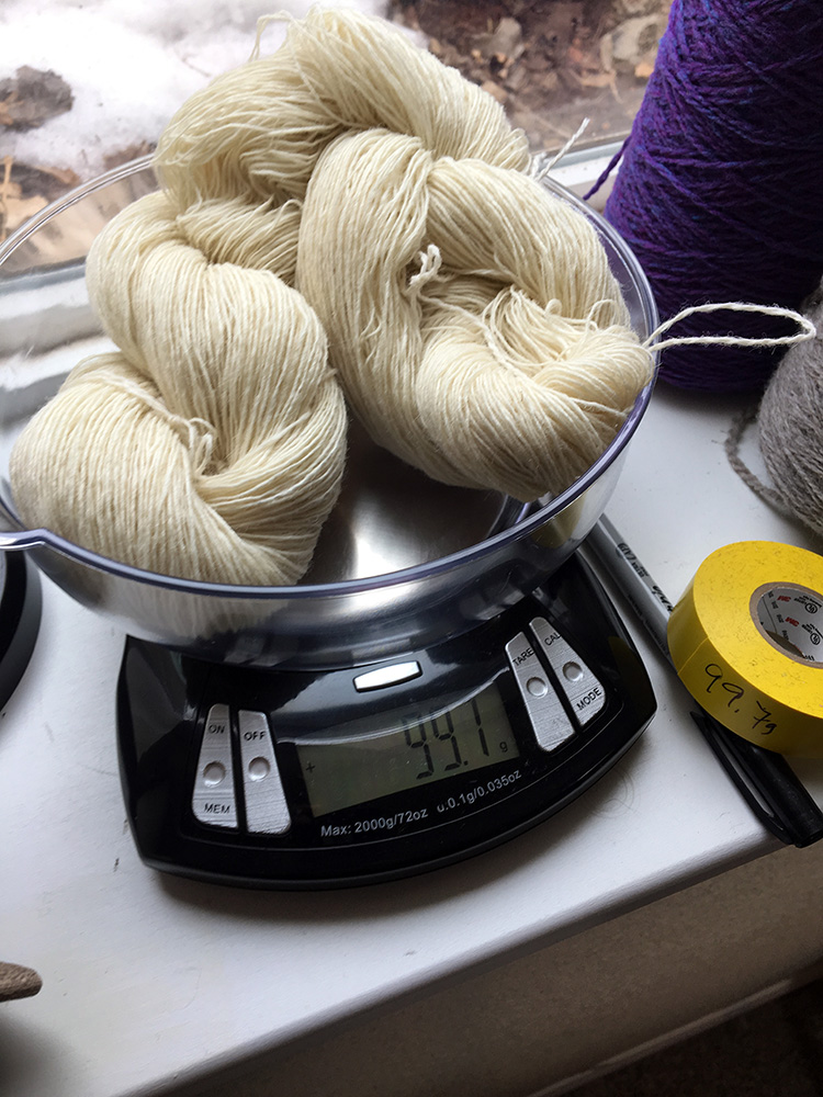 Weighing out skeins before dyeing.