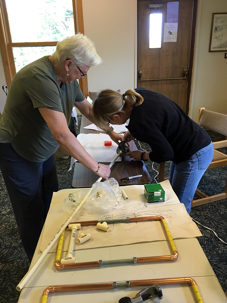 Wanda and Karen cutting PVC for Fringeless jigs.