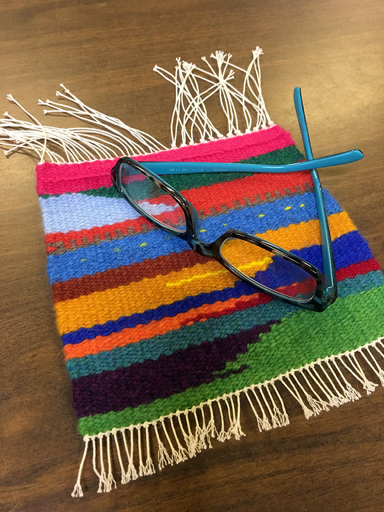 Norma's first weaving, glasses at the ready.