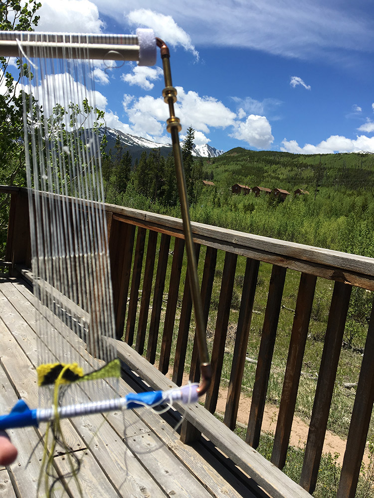 Far Away tapestry piece started on the cabin deck at CSU Mountain Campus, Colorado.