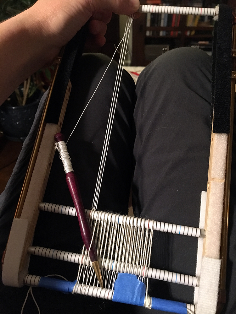 Warping the four selvedge tiny pipe loom for a 2 x 2 inch tapestry.