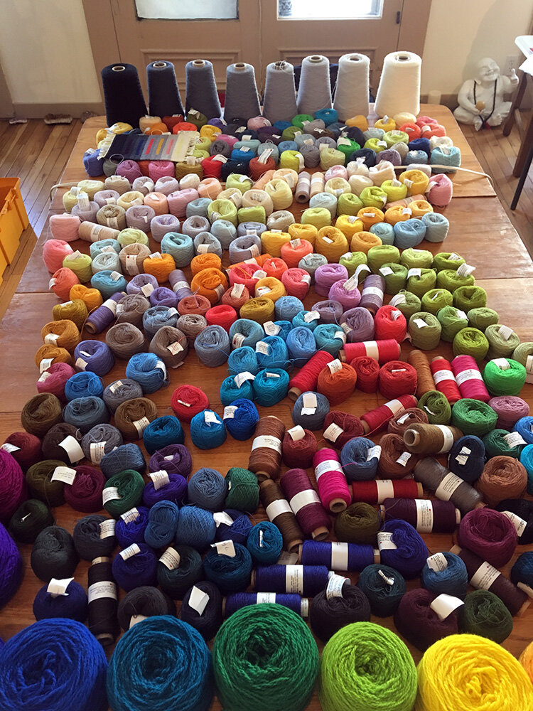 Yarn table arranged by value in color.