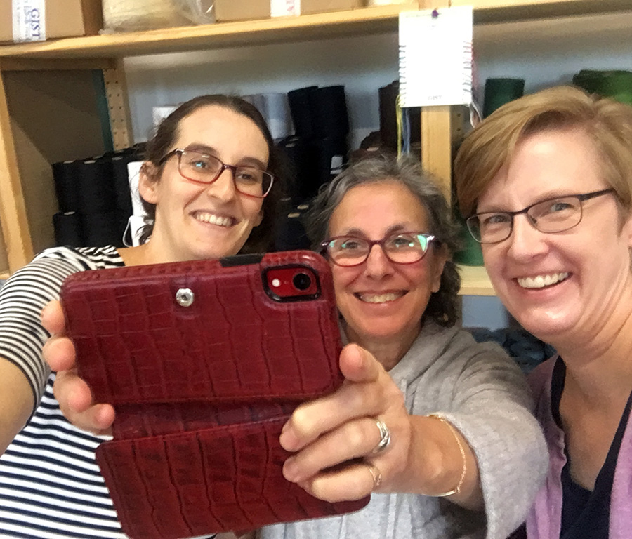 GIST Yarn owner Sarah Resnick, Mirrix Looms owner, Claudia Chase, and Rebecca Mezoff… goofing off as usual at GIST Yarn in Norwood, MA.