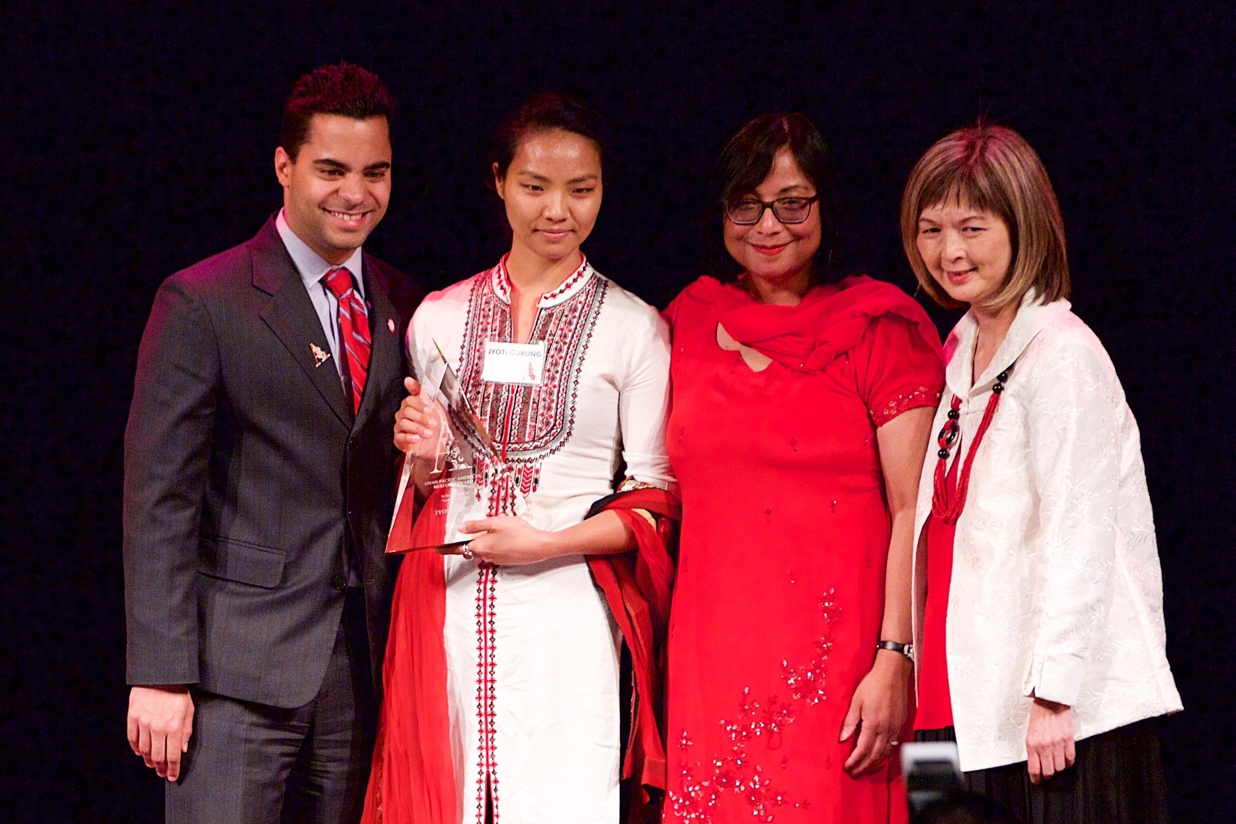 jyoti with award stage.jpg
