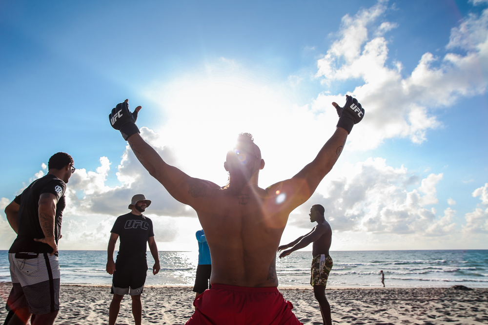 Before a morning workout on the beach in Boca Raton, FL, Vitor Belfort greets the sun.