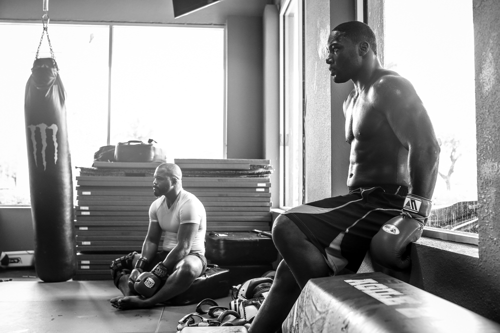 Teammates Rashad Evans and Anthony Johnson take a break to observe during striking practice.